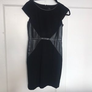 Fitted business dress with faux leather inserts.